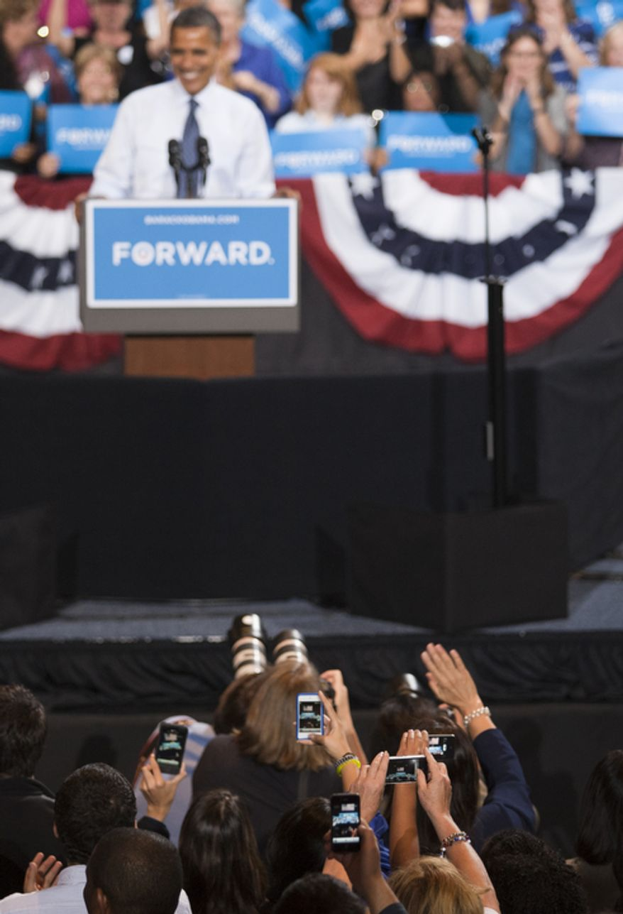 Supporters take photos during President Obama's campaign event Friday, Oct. 5, 2012, at George Mason University in Fairfax, Va. (Craig Bisacre/The Washington Times)