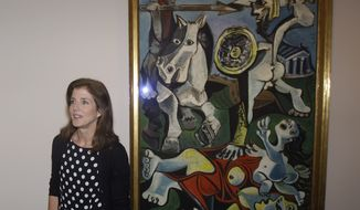 "Caroline Kennedy, president of the John F. Kennedy Library Foundation, unveils Pablo Picasso's painting ""Rape of the Sabine Women"" at the JFK Library and Museum in Boston on Thursday, Oct. 4, 2012. The painting is on loan to the library from the Museum of Fine Arts, Boston, in commemoration of the upcoming 50th anniversary of the Cuban Missile Crisis, which was Picasso's inspiration for the work. (AP Photo/Stephan Savoia)"