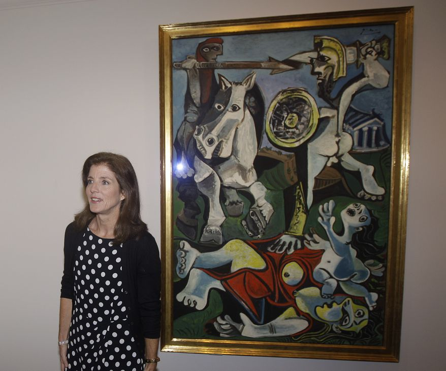 """Caroline Kennedy, president of the John F. Kennedy Library Foundation, unveils Pablo Picasso's painting """"Rape of the Sabine Women"""" at the JFK Library and Museum in Boston on Thursday, Oct. 4, 2012. The painting is on loan to the library from the Museum of Fine Arts, Boston, in commemoration of the upcoming 50th anniversary of the Cuban Missile Crisis, which was Picasso's inspiration for the work. (AP Photo/Stephan Savoia)"""