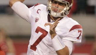 USC quarterback Matt Barkley throws a pass in the first quarter during the Trojans' 38-24 road win over Utah on Oct. 4, 2012. (Associated Press)