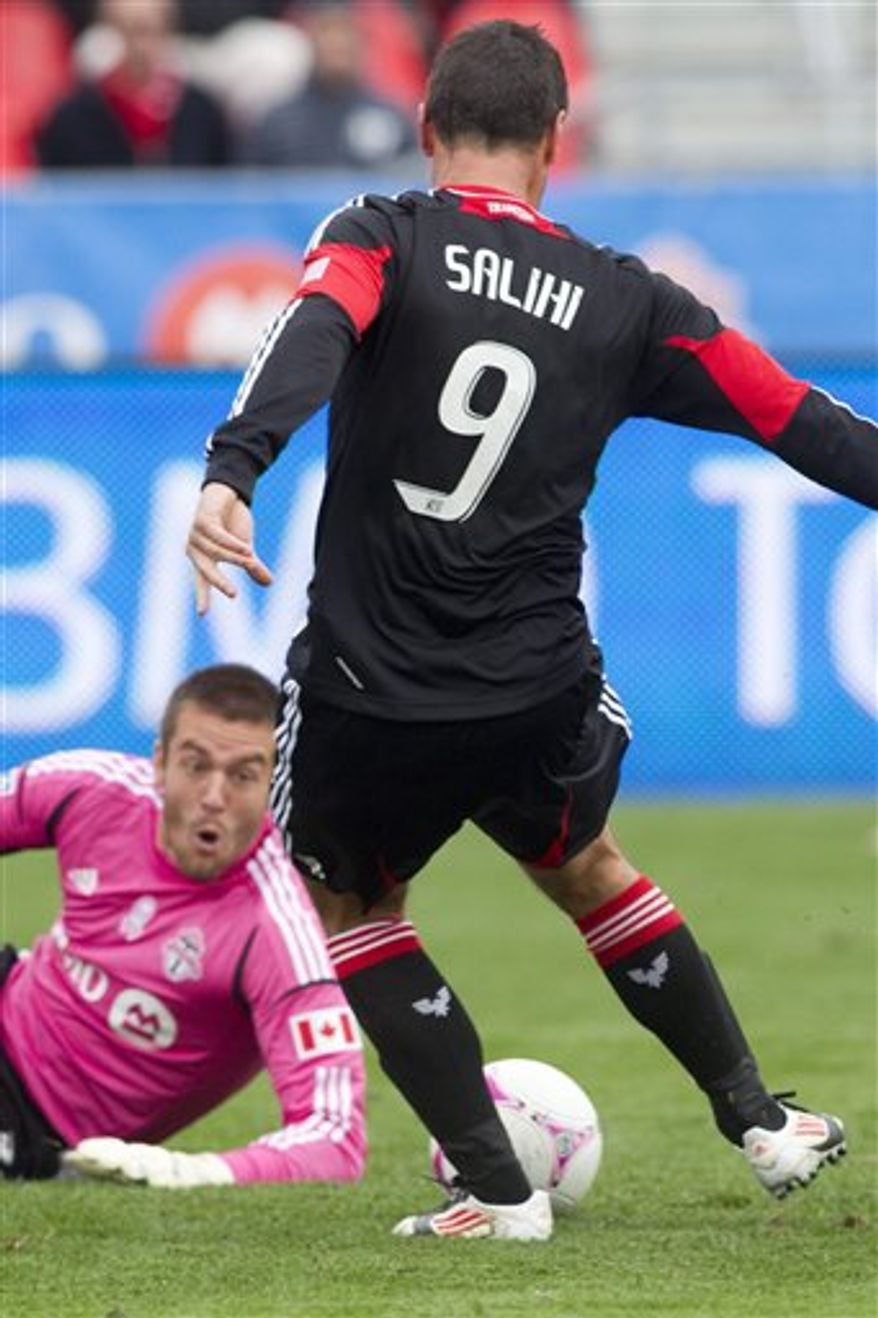 D.C. United's Hamdi Salihi, right, sweeps the ball past Toronto FC 's goalkeeper Milos Kocic to score his team's winning goal during second half MLS action in Toronto on Saturday, Oct. 6, 2012. D.C. United won 1-0(AP Photo/The Canadian Press, Chris Young)