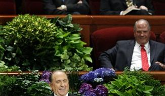 Mormon church President Thomas S. Monson speaks during the morning session of the 182nd Semiannual General Conference of the Church of Jesus Christ of Latter-day Saints in the Conference Center in Salt Lake City on Saturday, Oct. 6, 2012. Mr. Monson says the faith will lower its minimum age requirement for missionaries from 19 to 18 for men and from 21 to 19 for women. (AP Photo/The Deseret News, Laura Seitz)