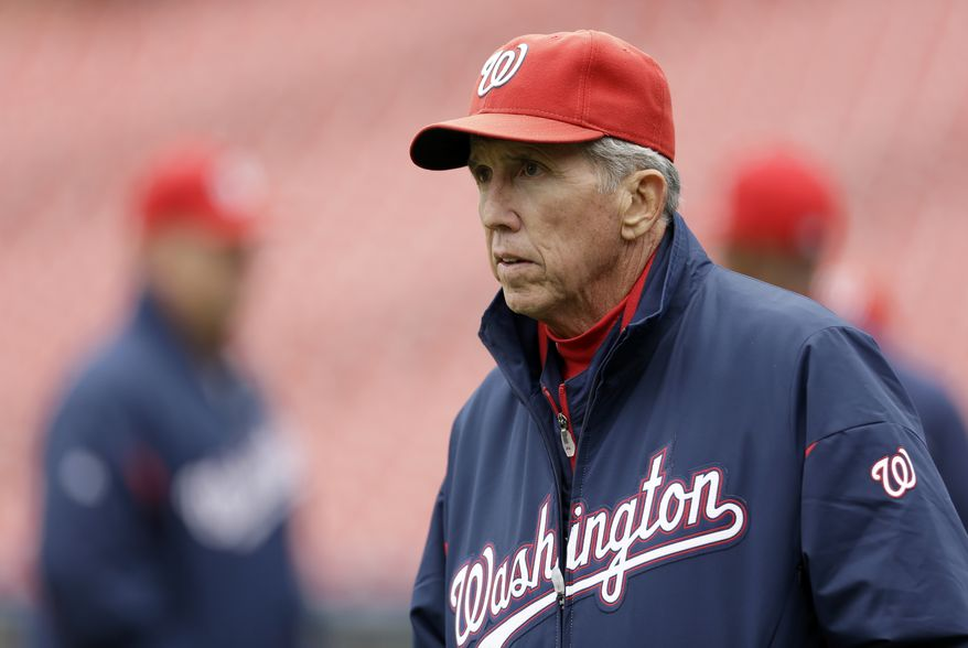 Manager Davey Johnson took in the Nationals' workout at Busch Stadium on Saturday. (Associated Press)