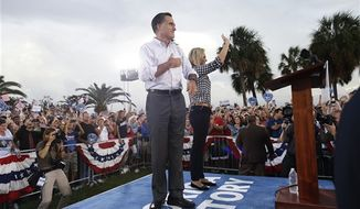 Republican presidential candidate and former Massachusetts Gov. Mitt Romney campaigns with wife Ann in St. Petersburg, Fla., Friday, Oct. 5, 2012. (AP Photo/Charles Dharapak)