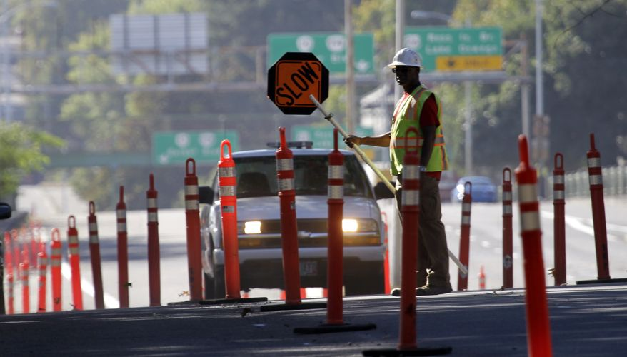 A worker directs traffic for street construction in Portland, Ore., Friday, Oct. 5, 2012. The Labor Department reported Friday that the unemployment rate fell to 7.8 percent in September, a decline of 0.3 percentage point and the lowest since January 2009. The government said the economy created 114,000 jobs, about as expected, and generated 86,000 more jobs in July and August than first estimated.(AP Photo/)