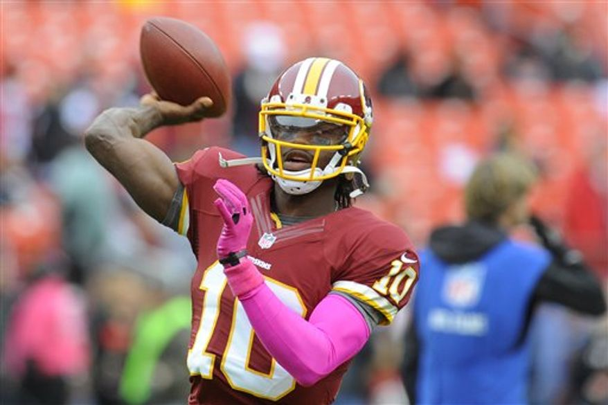 Robert Griffin III wearing pink sleeve as part of breast cancer awareness initiative. (Associated Press)