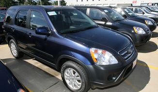 ** FILE ** A long line of unsold 2006 Honda CR-V crossovers sits on the lot of a Honda dealership in the south Denver suburb of Littleton, Colo., in August 2006. Honda is recalling CR-V crossovers from the 2002 to 2006 model years because an electrical switch in the driver's side door could melt and cause a fire. (AP Photo/David Zalubowski)