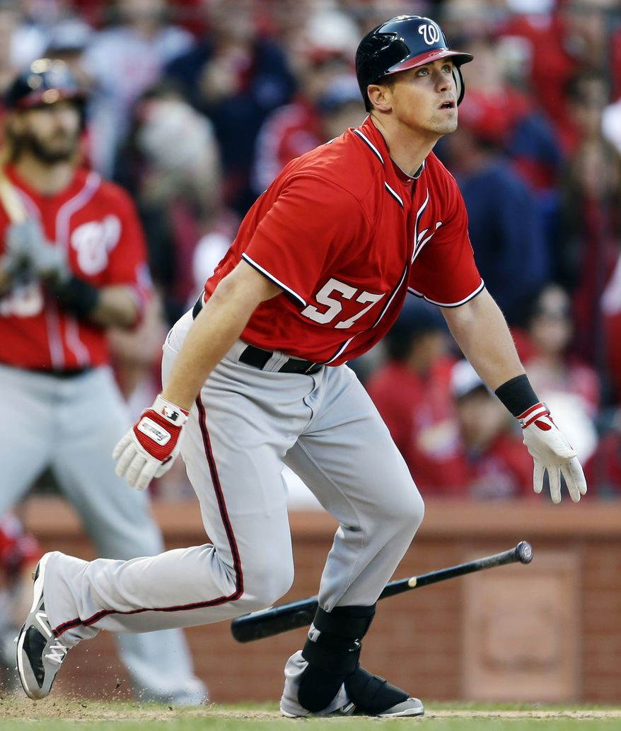 Washington Nationals' Tyler Moore watches his two-RBI single during the eighth inning in Game 1 of baseball's National League division series against the St. Louis Cardinals, Sunday, Oct. 7, 2012, in St. Louis. (AP Photo/Jeff Roberson)
