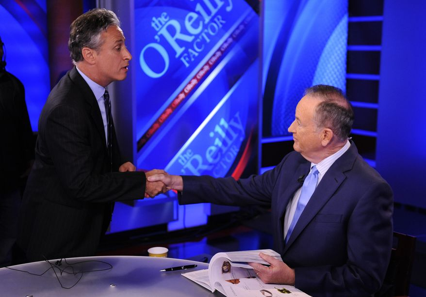 ** FILE ** Comedy Central's Jon Stewart (left) and Bill O'Reilly of Fox News tape an interview in New York in September 2010. (AP Photo/Peter Kramer)