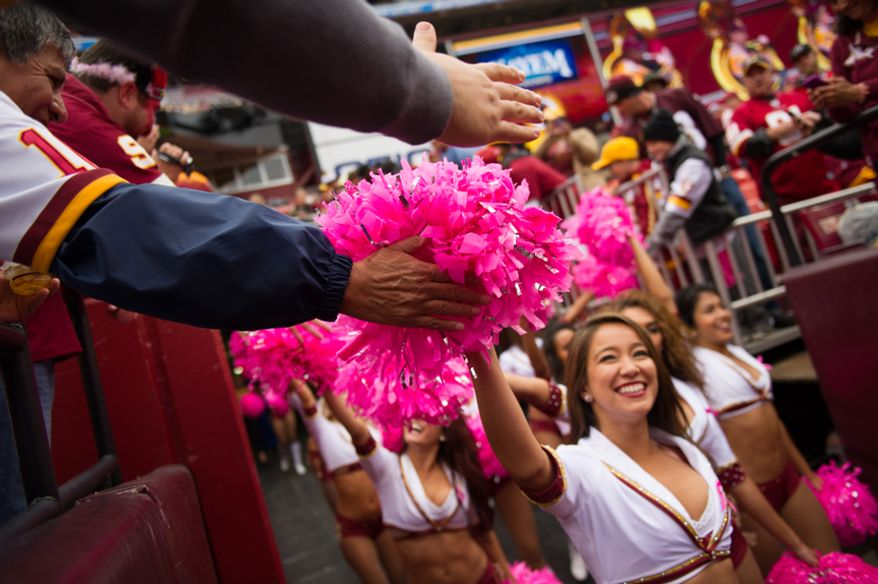 The Redskins cheerleaders wear pink as they take the field for breast cancer awareness month as the Washington Redskins play the Atlanta Falcons at FedEx Field, Landover, Md., Sunday, October 7, 2012. (Andrew Harnik/The Washington Times)