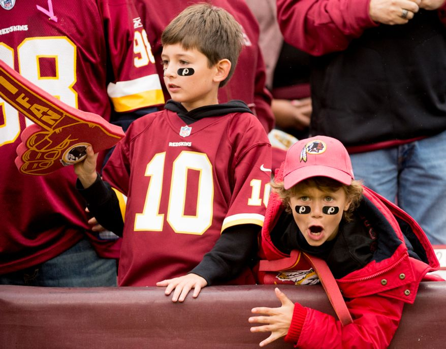 Nate Owen, 8, left, and Jack Dougan, 9, right, of Reston, Va., cheer on the Washington Redskins as they play the Atlanta Falcons at FedEx Field, Landover, Md., Sunday, October 7, 2012. (Andrew Harnik/The Washington Times)