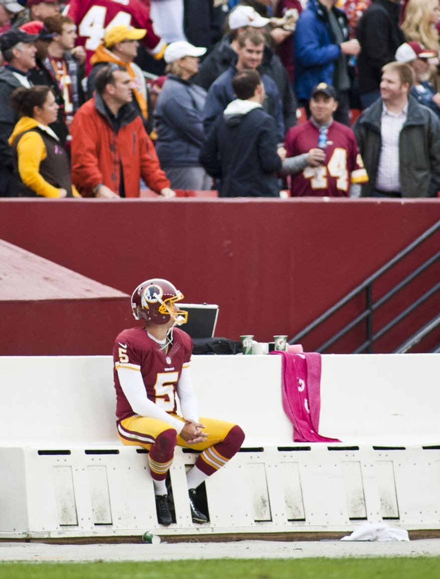 Washington Redskins kicker Billy Cundiff (5) sits alone on the beach after missing a 31 yard field goal wide right in the second quarter against the Atlanta Falcons, Landover, Md., Sunday, Oct. 7, 2012.  (Craig Bisacre/The Washington Times)