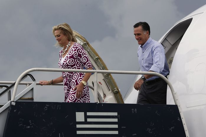Republican presidential candidate Mitt Romney and his wife, Ann, arrive in West Palm Beach, Fla., on Sunday, Oct. 7, 2012. (AP Photo/Charles Dharapak)
