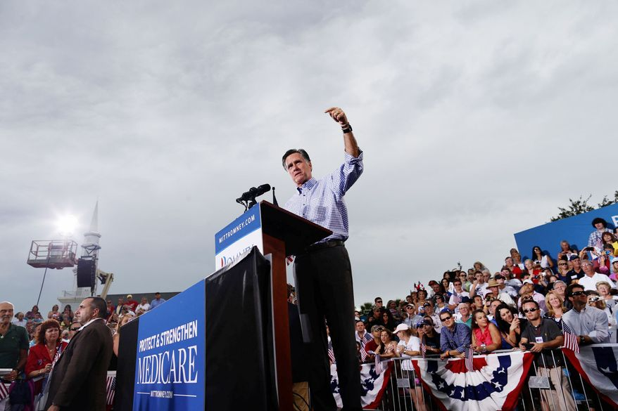 Republican presidential candidate Mitt Romney tells a crowd of 9,000 in Port St. Lucie, Fla., on Sunday that President Obama has failed to fulfill his promise to cut health care costs. (Associated Press)