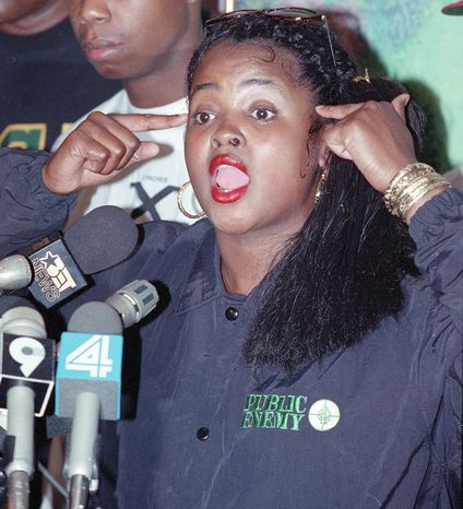 Sister Souljah speaks at an event in New York in 1992, the year presidential candidate Bill Clinton blasted her comments after the Rodney King beating. (Associated Press)