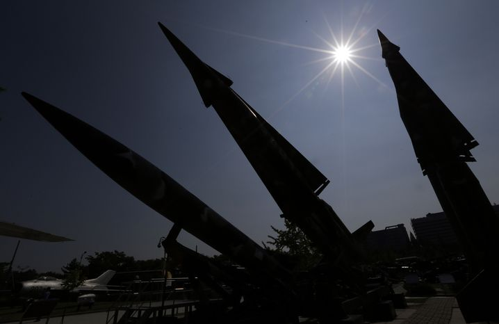 Mock South Korean missiles are silhouetted at the War Memorial of Korea museum in Seoul on Sunday, Oct. 7, 2012. South Korea said the United States has agreed to allow it to develop longer-range missiles that could strike all of North Korea. (AP Photo/Lee Jin-man)