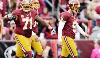 Billy Cundiff walks off the field while left tackle Trent Williams reacts in frustration after the Redskins kicker missed a 31-yard field goal during a 24-17 loss to the Atlanta Falcons on Sunday. (Preston Keres/Special to The Washington Times)