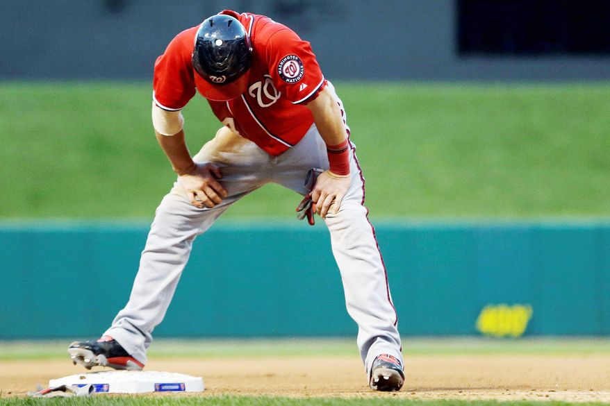 Washington Nationals' Bryce Harper pauses after being tagged out at third during the seventh inning in Game 2 of baseball's National League division series against the St. Louis Cardinals, Monday, Oct. 8, 2012, in St. Louis. (AP Photo/Jeff Roberson)