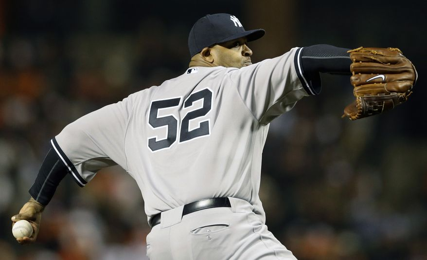 New York Yankees starting pitcher CC Sabathia throws to the Baltimore Orioles in the sixth inning of Game 1 of the American League division baseball series on Sunday, Oct. 7, 2012, in Baltimore. (AP Photo/Patrick Semansky)
