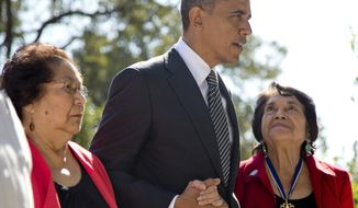 President Obama walks with Cesar Chavez's widow, Helen F. Chavez (left), and Dolores Huerta, co-founder of the United Farm Workers, as they tour the Cesar E. Chavez National Monument Memorial Garden in Keene, Calif., on Monday. (Associated Press)