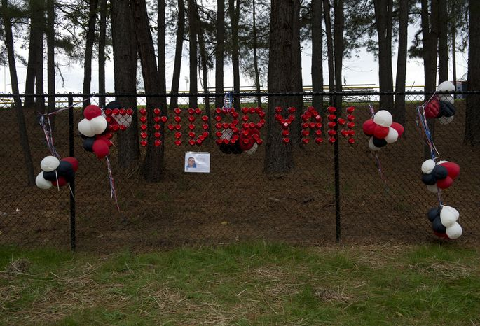 """The message """"Find Bryan"""" is written in red plastic cups on a fence outside W.T. Woodson High School along with a flier about missing Woodson senior Bryan Glenn. A body was found off the trail in Thaiss Memorial Park in Fairfax, Va. on Monday, Oct. 8, 2012. Fairfax County Police have not yet determined if it is Glenn, who was last seen Oct. 1 when he dropped his brother off at school and whose car was found in the park's parking lot on Tuesday. A search party set out near 10 a.m. this morning and a small group later found the body. (Barbara L. Salisbury/The Washington Times)"""