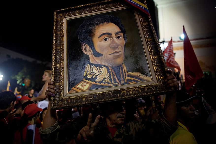 A supporter of Venezuelan President Hugo Chavez carries a painting of independence hero Simon Bolivar outside the Miraflores Palace as they celebrate in Caracas, Venezuela, on Sunday, Oct. 7, 2012. Venezuela's electoral council said late Sunday that President Hugo Chavez had won re-election, defeating challenger Henrique Capriles. (AP Photo/Ramon Espinosa)