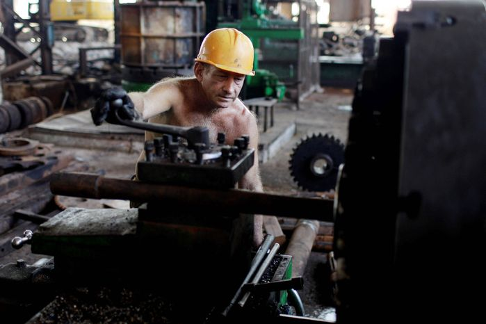 Aristeo Manzano, 58, repairs machinery at the Brasil sugar processing plant in Jaronu, Cuba. (Associated Press)