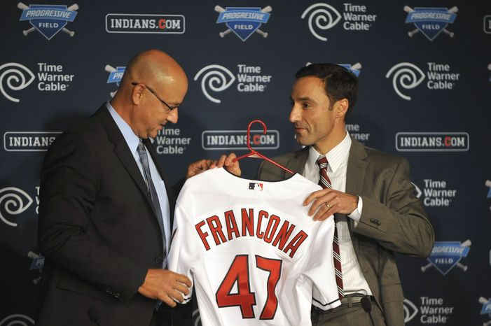 Cleveland Indians general manager Chris Antonetti, right, presents new manager Terry Francona with a baseball jersey during a news conference at Progressive Field, Monday, Oct. 8, 2012. (AP Photo/David Richard)