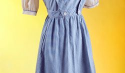 "This photo provided by Julien's Auctions shows the original costume worn by Judy Garland in the film ""The Wizard of Oz."" (Associated Press/Julien's Auctions)"