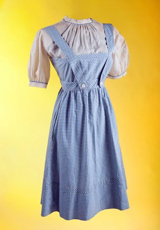 """This photo provided by Julien's Auctions shows the original costume worn by Judy Garland in the film """"The Wizard of Oz."""" (Associated Press/Julien's Auctions)"""
