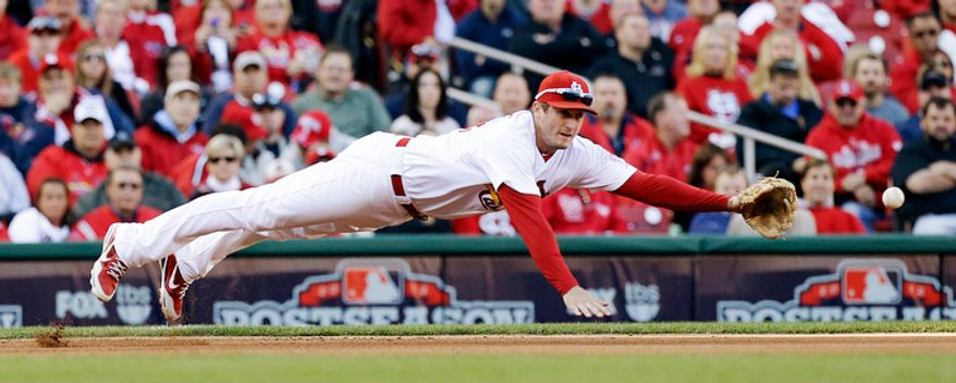 St. Louis Cardinals third baseman David Freese dives after a single by Washington Nationals' Michael Morse during the third inning of Game 2. The Cardinals won 12-4. (AP Photo/St. Louis Post-Dispatch, Chris Lee)