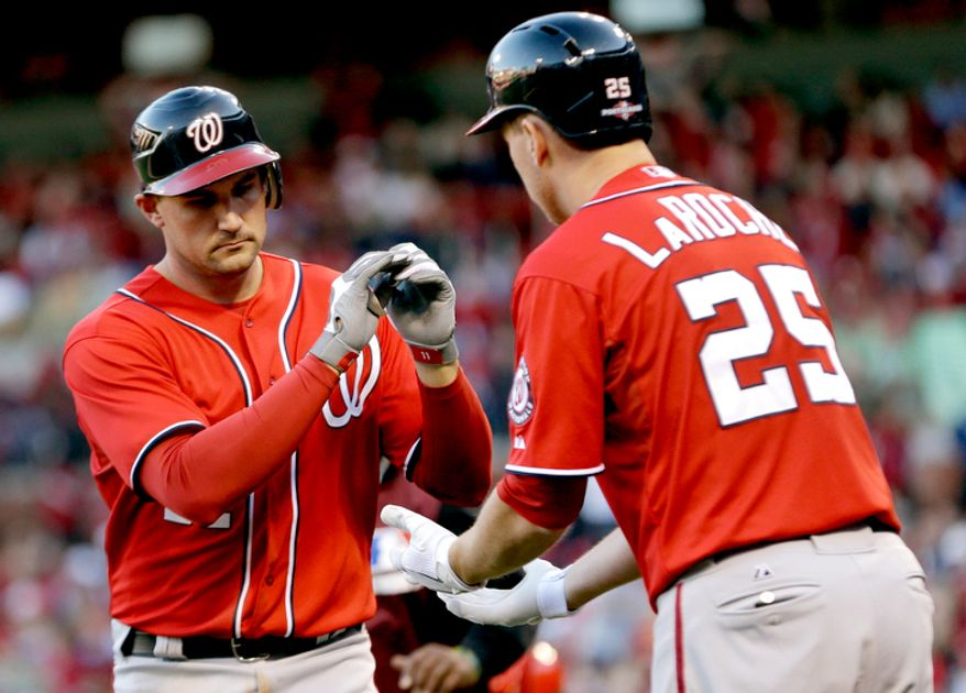 Washington Nationals' Ryan Zimmerman, left, is congratulated by Adam LaRoche after hitting a solo home run during the fifth inning in Game 2. (AP Photo/Jeff Roberson)