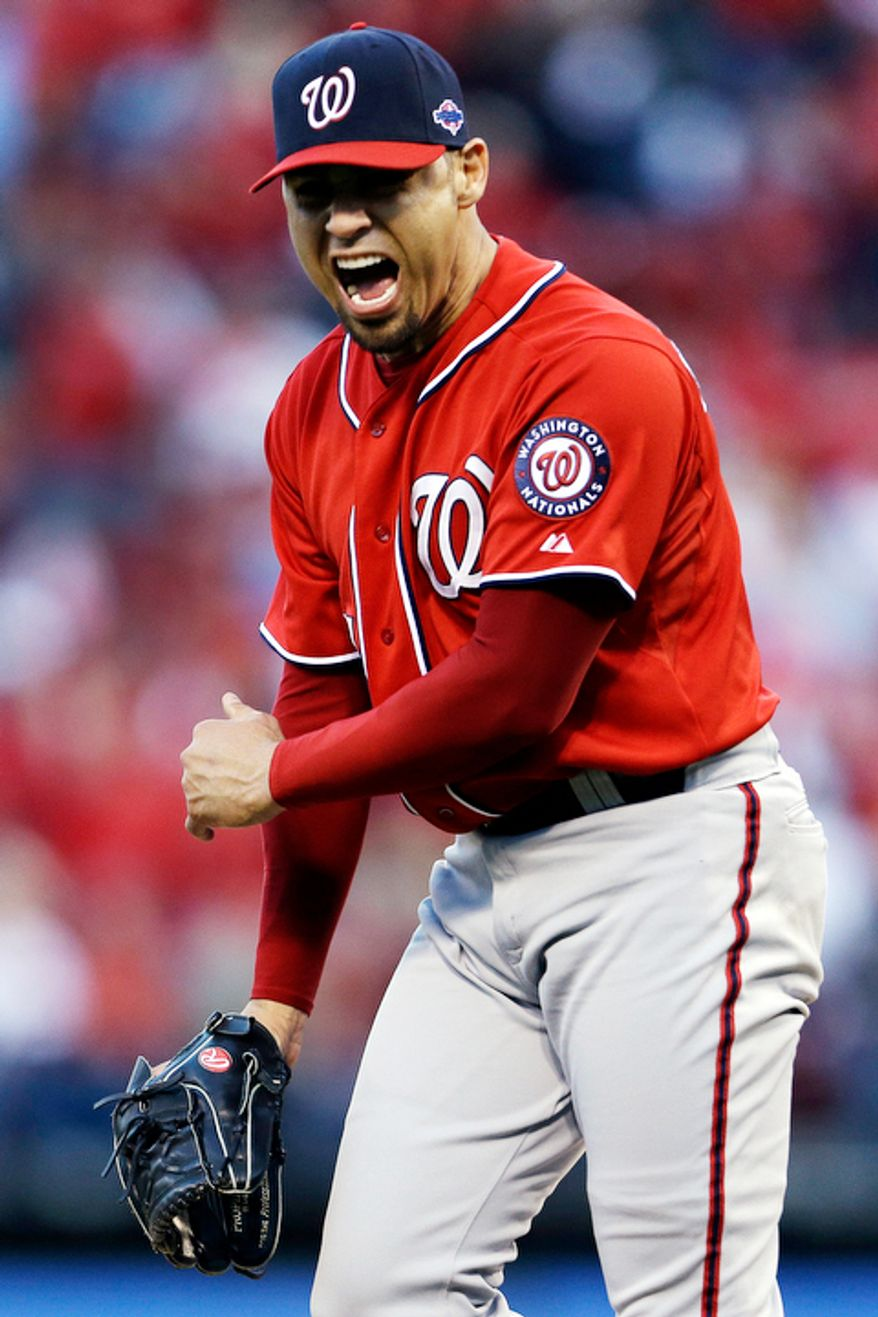 Washington Nationals relief pitcher Mike Gonzalez yells after giving up a solo home run to St. Louis Cardinals' Carlos Beltran during the sixth inning in Game 2. (AP Photo/Jeff Roberson)