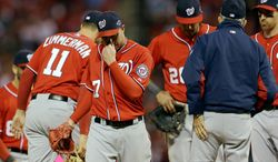 Washington Nationals relief pitcher Sean Burnett walks off the mound after being pulled during the eighth inning. (AP Photo/Jeff Roberson)