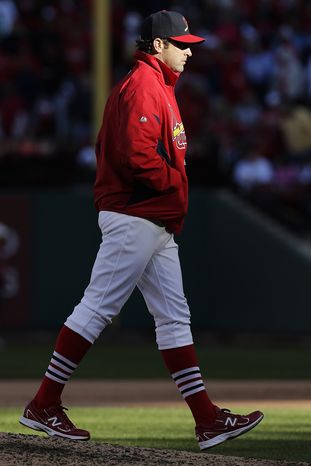 St. Louis Cardinals manager Mike Matheny walks back to the dugout after making a pitching change during the sixth inning of Game 1 of the National League division baseball series against the Washington Nationals, Sunday, Oct. 7, 2012, in St. Louis. (AP Photo/Charlie Riedel)