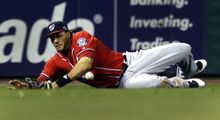 Washington Nationals left fielder Michael Morse cannot catch a ball hit by St. Louis Cardinals' Pete Kozma for a double during the eighth inning in Game 2 of baseball's National League division series, Monday, Oct. 8, 2012, in St. Louis. (AP Photo/Jeff Roberson)