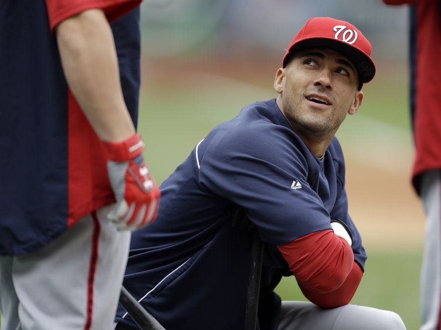 Washington Nationals' Ian Desmond, right, looks up as he talks with teammate Bryce Harper during baseball practice, Saturday, Oct. 6, 2012, in St. Louis. The Nationals and the St. Louis Cardinals are scheduled to play Game 1 in the National League division series on Sunday. (AP Photo/Jeff Roberson)