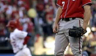 St. Louis Cardinals' Allen Craig, left, rounds the bases after hitting a solo home run off Washington Nationals starting pitcher Jordan Zimmermann during the third inning in Game 2 of baseball's National League division series, Monday, Oct. 8, 2012, in St. Louis. (AP Photo/Jeff Roberson)