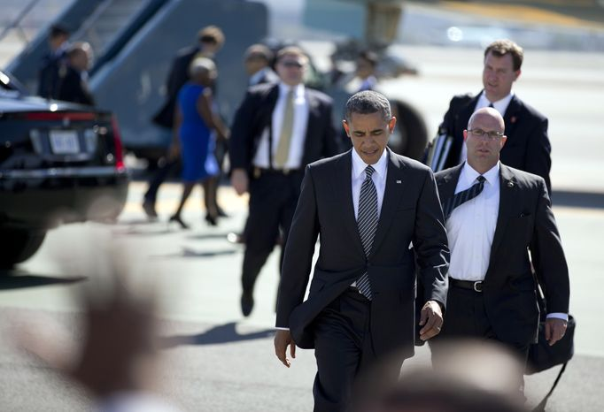 President Obama crosses the tarmac to greet supporters as he arrives Oct. 8, 2012, on Air Force One at San Francisco International Airport. (Associated Press)