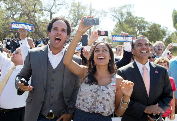 Actress Rosario Dawson (center) and Los Angeles Mayor Mayor Antonio Villaraigosa (right) cheer Oct. 8, 2012, as President Obama speaks at the establishment of the Cesar E. Chavez National Monument in Keene, Calif. (Associated Press)