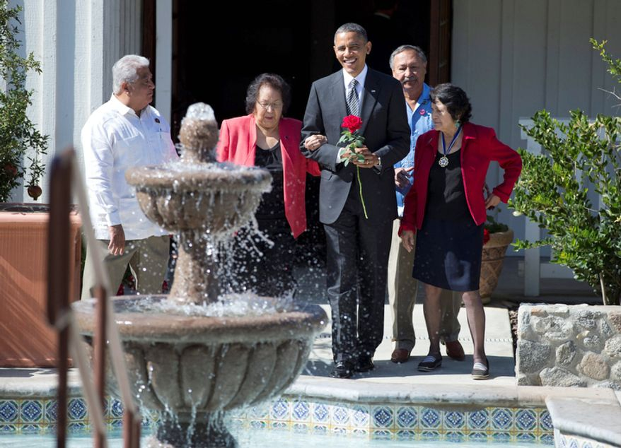 President Obama holds a commemorative red rose as he walks with Cesar Chavez' widow, Helen F. Chavez (second from left); Chavez' son, Paul F. Chavez (left), president of the Cesar E. Chavez Foundation; Dolores Huerta (right), co-founder of the United Farm Workers; and Arturo S. Rodriguez, president of the United Farm Workers, as they tour the Cesar E. Chavez National Monument Memorial Garden in Keene, Calif., on Oct. 8, 2012. (Associated Press)