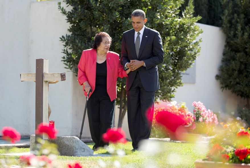 President Obama and Helen F. Chavez, widow of Cesar Chavez, places a special red rose at the Chavez grave site in Keene, Calif., on Oct. 8, 2012, as he tours the Cesar E. Chavez National Monument Memorial Garden. (Associated Press)