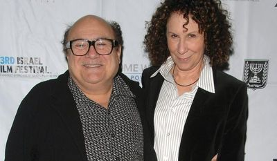 Actors Danny DeVito and Rhea Perlman attend the opening night of the 23rd annual Israel Film Festival at the Ziegfeld Theatre in New York in 2008. (AP Photo/Peter Kramer)