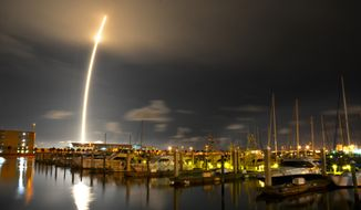 SpaceX's Falcon 9 rocket successfully lifts off from Cape Canaveral Air Force Station in Florida on Sunday, Oct. 7, 2012, to take supplies to the International Space Station. (AP Photo/Florida Today, Malcolm Denemark)