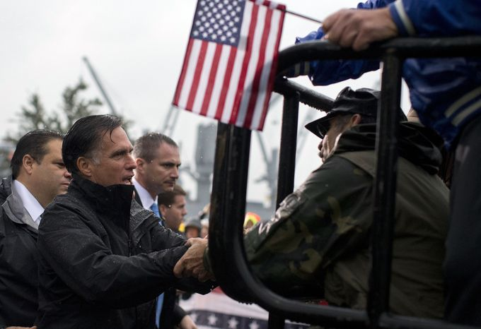 Republican presidential candidate Mitt Romney shakes hands Oct. 8, 2012, during a campaign rally in Newport News, Va. (Asso