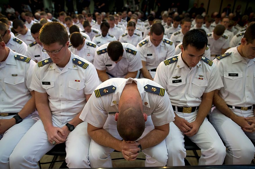 Cadets at the Virginia Military Institute pray before a foreign policy speech by Republican presidential candidate Mitt Romney on Monday, Oct. 8, 2012, in Lexington, Va. (AP Photo/Evan Vucci)