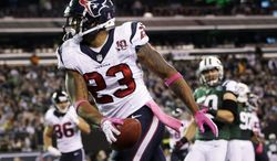 Houston Texans running back Arian Foster (23) celebrates after rushing for a touchdown during the first half of an NFL football game against the New York Jets, Monday, Oct. 8, 2012, in East Rutherford, N.J. (AP Photo/Kathy Willens)