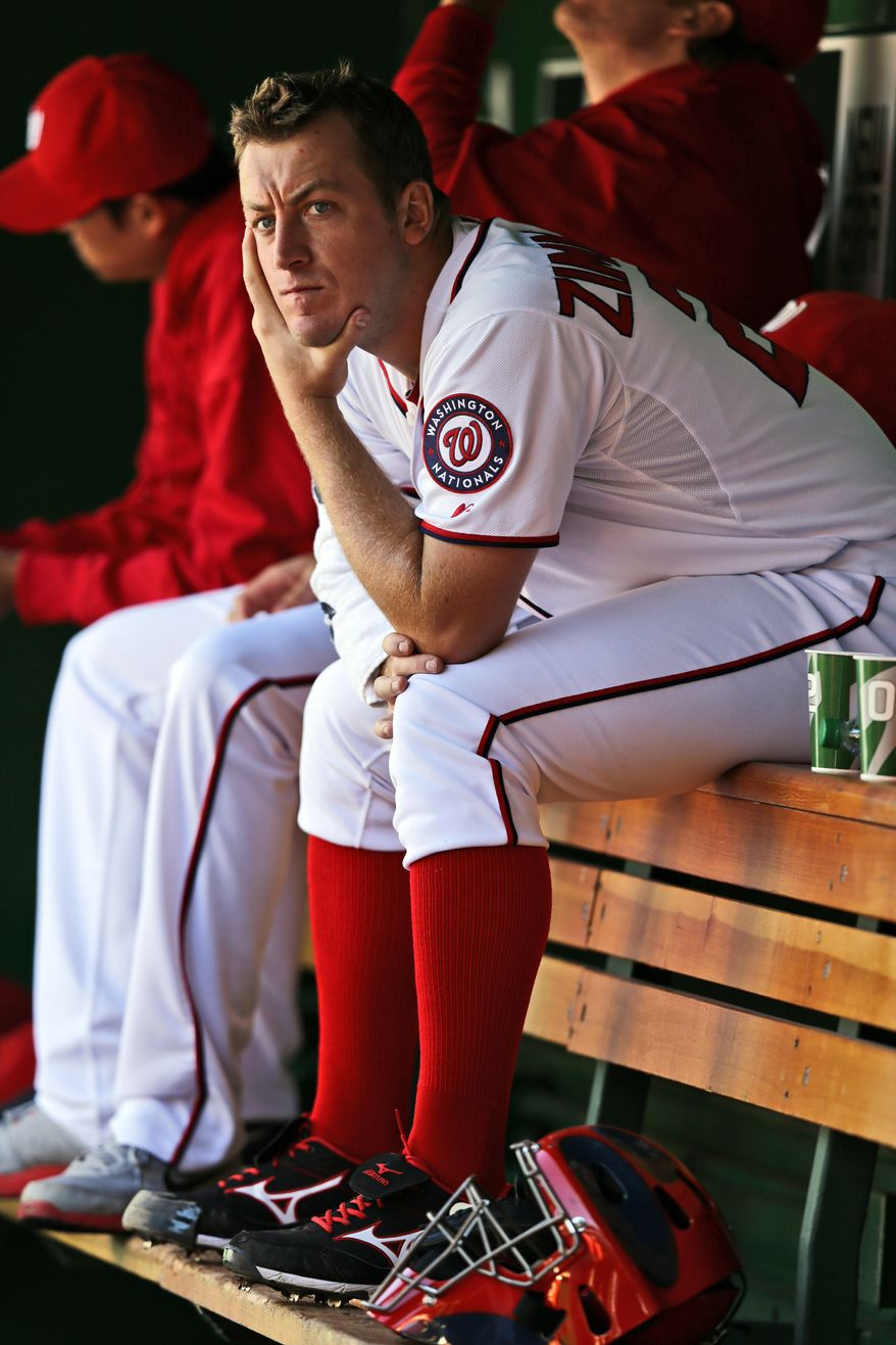 Washington Nationals starting pitcher Jordan Zimmermann pauses in the dugout during a baseball game against the Milwaukee Brewers at Nationals Park on Monday, Sept. 24, 2012, in Washington. The Nationals won 12-2. (AP Photo/Alex Brandon)