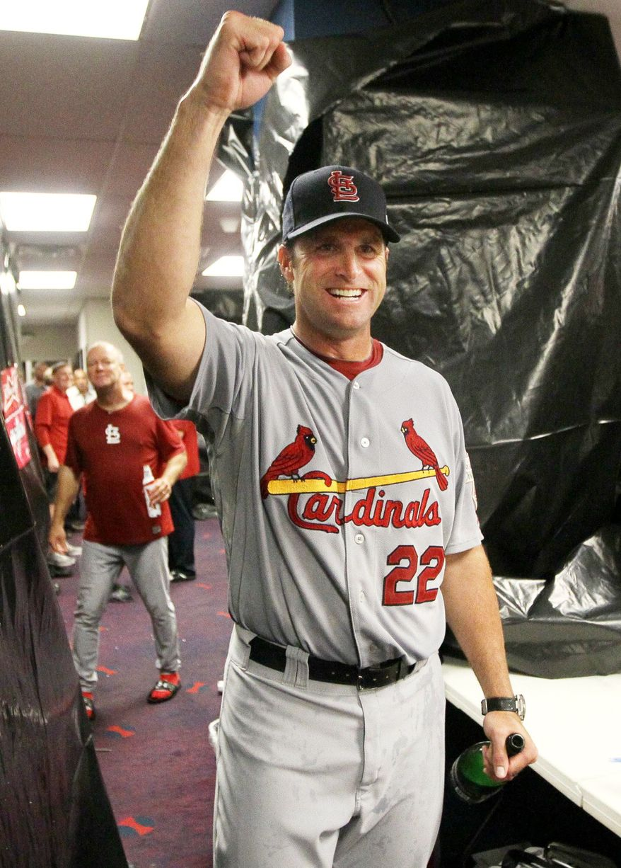 St. Louis Cardinals manager Mike Matheny celebrates in the clubhouse after a National League wildcard playoff game against the Atlanta Braves, Friday, Oct. 5, 2012, at Turner Field in Atlanta. The Cardinals won 6-3. (AP Photo/St. Louis Post-Dispatch, Chris Lee) EDWARDSVILLE INTELLIGENCER OUT; THE ALTON TELEGRAPH OUT