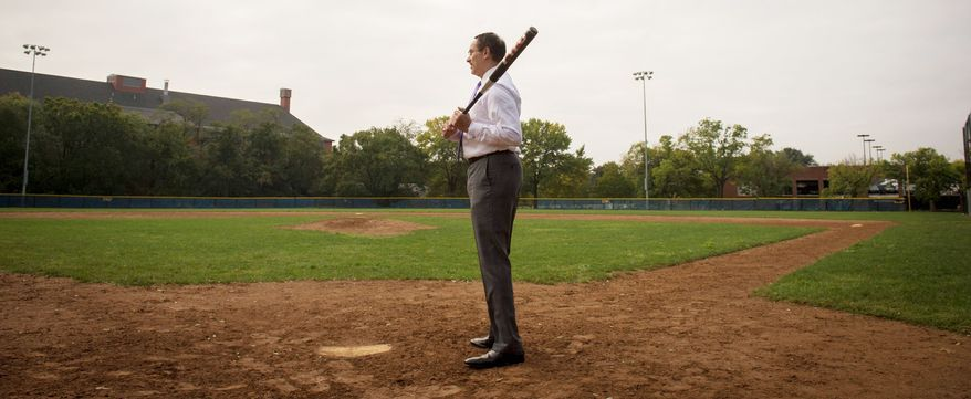 D.C. Mayor Vincent C. Gray stands at the plate at Brentwood Hamilton Field in Northeast, a diamond where he played as a child. His favorite Washington player was Mickey Vernon. (Rod Lamkey Jr./The Washington Times)